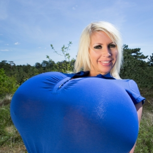 Beshine Gigantic Breasts In A Blue Shirt