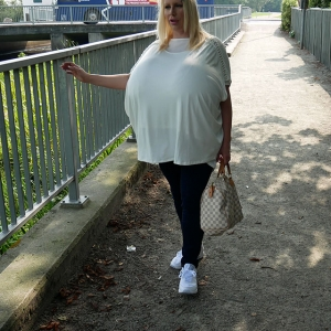 Blonde in public with immensely large funbags