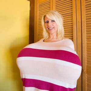 Woman Who Has Undergone Extreme Breast Augmentations
