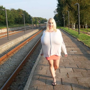Mega stacked blonde and her enormous implants